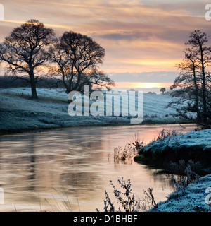 The flooded river Derwent at Howsham Bridge, north Yorkshire, at sunset in mid-winter. - Stock Photo