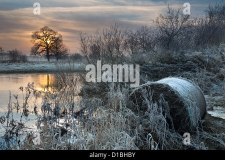 Sunset over the River Derwent at Howsham Bridge, north Yorkshire,  in mid-winter following floods. - Stock Photo
