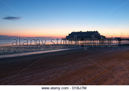 Cleethorpes pier during a frosty morning sunrise, Lincolnshire, UK. - Stock Photo