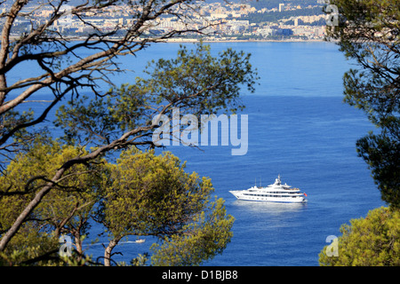 Top view above the bay from the natural park of Mont Boron in Nice city - Stock Photo