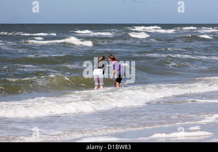 Amrum, Fog, Germany, two girls in the surf of the North Sea - Stock Photo