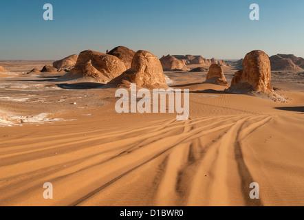 4WD Tracks in Sand, El Akabat (Agabat) Rock Formations, Libyan (Western) Desert, Egypt - Stock Photo