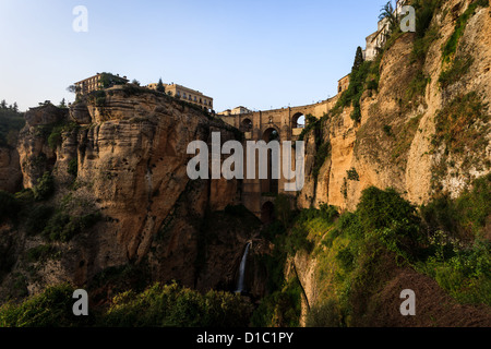 Both sides of Ronda, Spain connected by the ancient bridge spanning the Tajo Gorge - Stock Photo