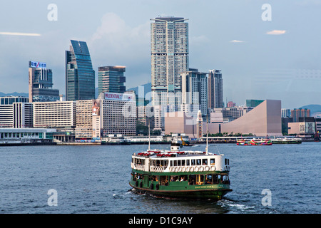 Star Ferry crossing Victoria Harbour toward Kowloon Hong Kong. - Stock Photo