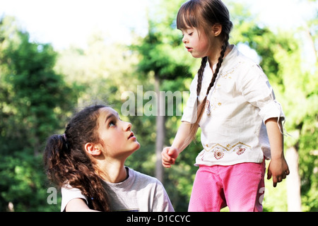 Little girl with sister - Stock Photo