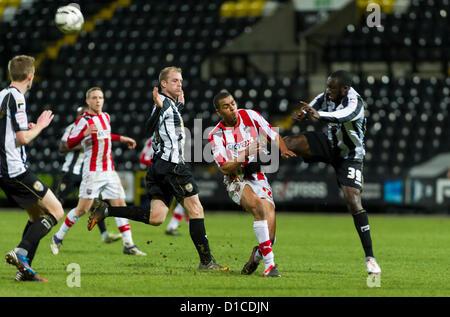 15.12.2012 Nottingham, England.  Notts County's Damion Stewart (sub) collides with Brentford's Tom Adeyemi (sub) - Stock Photo