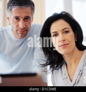 Man and woman at home License free except ads and billboards - Stock Photo