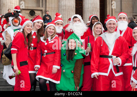 15 December 2012 London UK. Fancy dressed revellers outside St Paul's Cathedral during Santacon 2012. The annual - Stock Photo