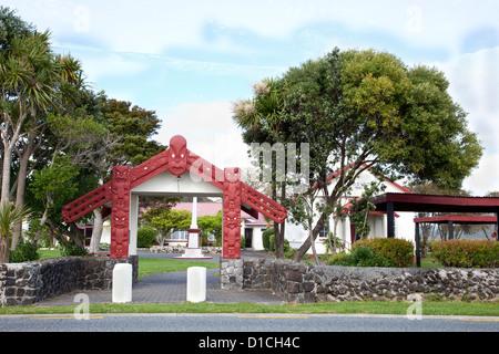 Entrance to Maori Te Tiriti o Waitangi Meeting House, erected 1964. Paihia, north island, New Zealand. - Stock Photo
