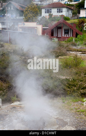 Geothermal Steam Flows from Hot Springs and Thermal Vents in the Maori Village of Ohinemutu, a suburb of Rotorua, - Stock Photo