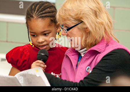 Teacher working on class presentation with black African American student age 5. Expo Elementary School St Paul - Stock Photo