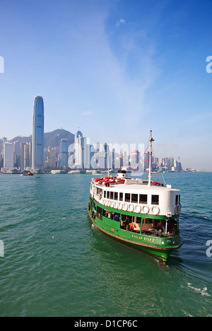 HONG KONG - DECEMBER 3: Ferry 'Solar star' leaving Kowloon pier on December 3, 2010 in Hong Kong, China. Ferry is - Stock Photo