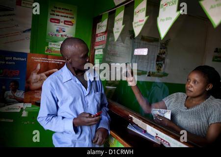 M-Pesa mobile-phone money transfer service in Kenya - Stock Photo