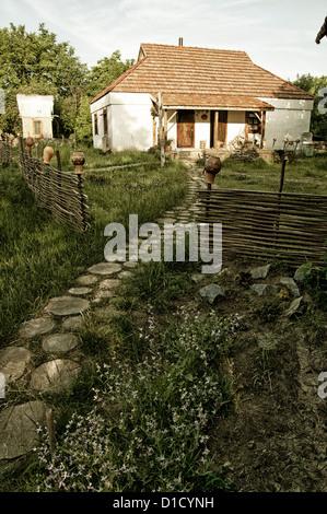 Traditional ukrainian rural house - Stock Photo