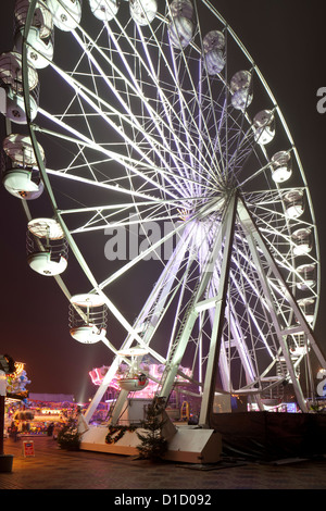 Big Wheel and fun fair in Centenary Square with the annual Christmas Market, City of Birmingham England, UK - Stock Photo