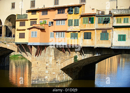 The Ponte Vecchio bridge and its shops spanning the Arno River, Florence Italy - Stock Photo