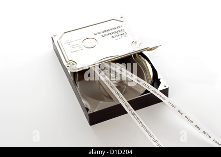 Half open hard drive and and a tape with the contents of the drive - Stock Photo