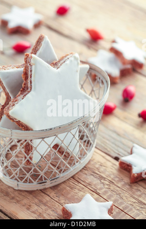Christmas Cookies baked in star shapes with sugar icing. - Stock Photo