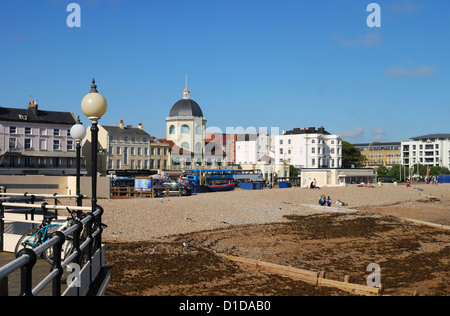 Seafront at Worthing. West Sussex. England. Viewed from the pier. With Art Deco Cinema (The Dome) and people enjoying - Stock Photo