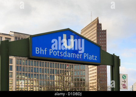 Bhf Potsdamer platz underground station sign at the entrance with modern buildings beyond in Potsdamerplatz, Berlin, - Stock Photo