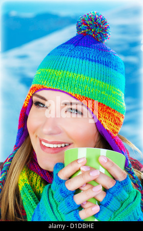 Image of beautiful girl drinking hot chocolate outdoor in winter park, pretty person having coffee, happy female - Stock Photo