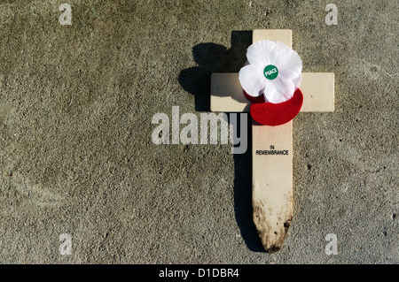 A single cross on the war memorial in Bromley, Kent following Remembrance Sunday. - Stock Photo