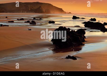 Portugal, Algarve: Romantic sunset at beach Praia do Amado - Stock Photo