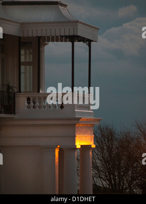 Last ray of late evening sun falls upon a balcony in Kemp Town,Brighton. - Stock Photo