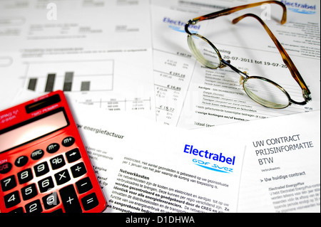 Calculator and Flemish invoice and contract of Electrabel, Belgian energy corporation, supplier of electricity and - Stock Photo