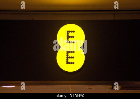 EE mobile phone network provider store shop sign logo, UK - Stock Photo