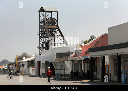 Tsumeb, Namibia. President street with shaft tower of the former copper mine - Stock Photo