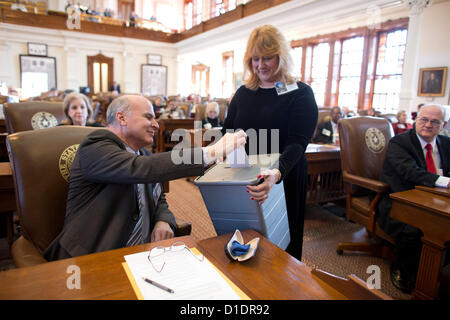 Electors cast ballots as the Texas Electoral College met at the Capitol in Austin, Texas. - Stock Photo