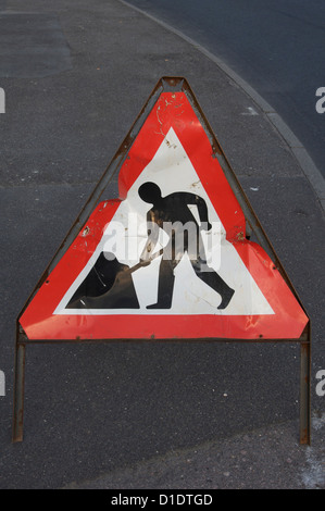 "British traffic signs. The familiar ""Road works ahead"" warning sign. A modern design classic by Jock Kinneir and - Stock Photo"
