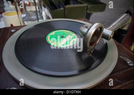 A record aficionado plays an antique 78 rpm record on an antique gramophone on New York - Stock Photo