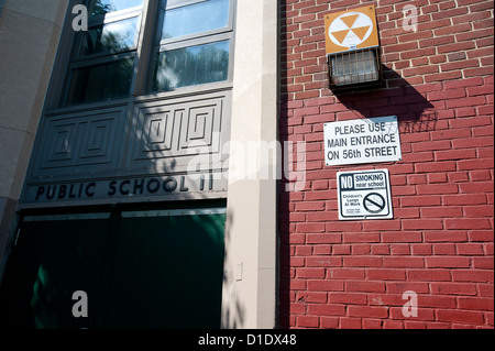 'No Smoking' sign on public school wall. - Stock Photo