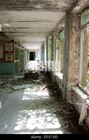 Chernobyl disaster results. This is corridor in abandoned school in small city Pripyat - Stock Photo