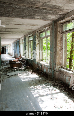 Chernobyl disaster results. This is corridor with scattered respirators in abandoned school in small city Pripyat - Stock Photo