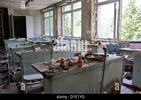 Chernobyl disaster results. This is chemistry classroom in abandoned school in small city Pripyat - Stock Photo