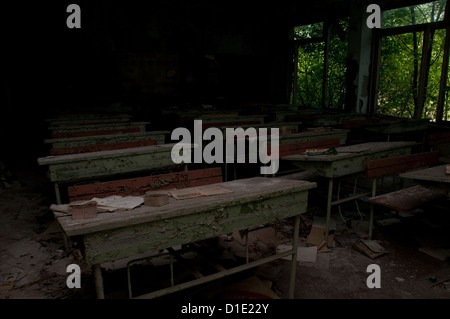 Chernobyl disaster results. This is classroom in abandoned school in small city Pripyat - Stock Photo