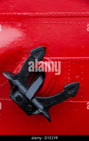 Black anchor on red steel ship, Helsinki, Finland - Stock Photo