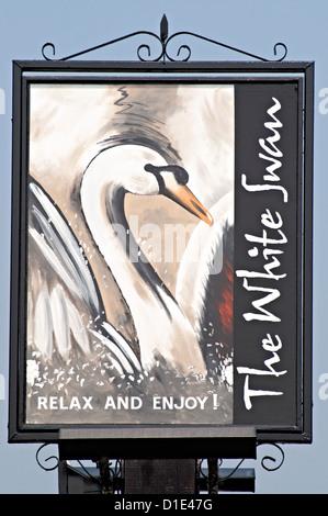 the white swan Pub sign - Stock Photo