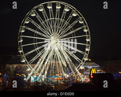 Chorley's 100ft Christmas ferris wheel, on the Flat Iron Car Park in Chorley Lancashire on Sunday 16th December - Stock Photo