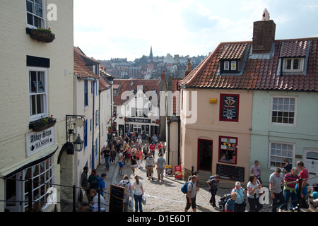 Tourists on the streets of Whitby on a summer day, Yorkshire, England, United Kingdom, Europe - Stock Photo