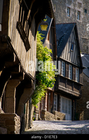 Medieval corbelled and half timbered mansions in cobbled street, Old Town, Dinan, Brittany, Cotes d'Armor, France, - Stock Photo