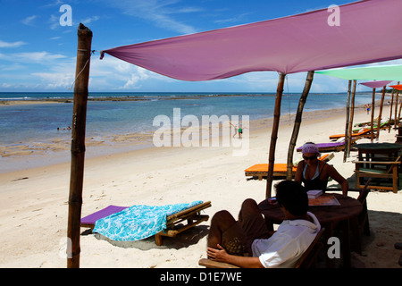 People at Parracho Beach, Arraial d'Ajuda, Bahia, Brazil, South America - Stock Photo