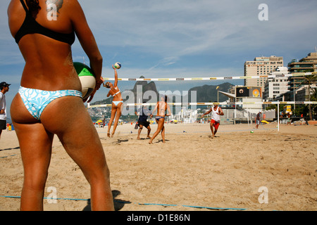 Women playing volleyball on Ipanema beach, Rio de Janeiro, Brazil, South America - Stock Photo