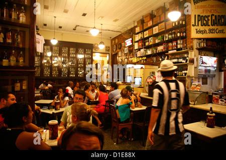 People sitting at Armazem Sao Thiago (Bar do Gomes) in Santa Teresa neighbourhood, Rio de Janeiro, Brazil, South - Stock Photo