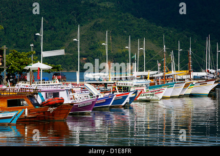 Colorful fishing boats in the harbour, Parati, Rio de Janeiro State, Brazil, South America - Stock Photo