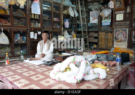 Shop owner in the Kumartuli district of Kolkata, West Bengal, India, Asia - Stock Photo