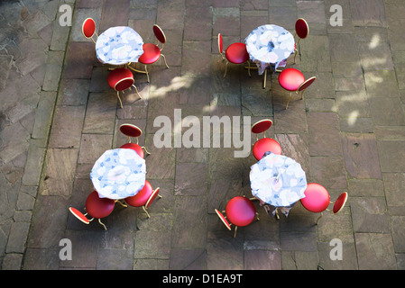 Overhead view of a outdoor cafe tables with chairs on stone floor - Stock Photo